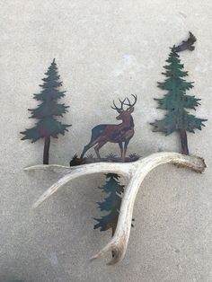"""HIGH COUNTRY DESIGNS ANTLER ART This Beautiful Rustic Wall Art is made of Authentic Deer Antler, and Precision Cut Metal. Approximately 28 3/4"""" high and 21"""" wide. Enhance your decor with the additi"""