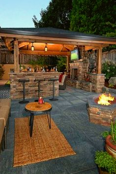 An outdoor kitchen can be an addition to your home and backyard that can completely change your style of living and entertaining. Outdoor Kitchen Grill, Patio Kitchen, Outdoor Kitchen Design, Backyard Pavilion, Backyard Patio Designs, Backyard Landscaping, Backyard Fireplace, Outdoor Decor, Modern Farmhouse