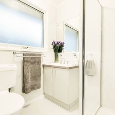 Plain white bathroom?  Add a touch of colour with a vase of beautiful iris.  Credit to @snapmediagroup for the pic #localhomestaging #homestaging #interior #interiordecorating #green #indoorplants #bathroom #realestatephotography #realestate