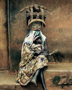 The Yoruba People are a large ethnic group living in Nigeria and Benin. The Yoruba have legendary types of clothes that make them distinct from other cultures around them. They take immense pride in their attire, for which they are well known. They believe that the type of clothes worn by a man depicts his personality and social status, and that different occasions require different clothing outfits.  Photo by: David Paul Carr