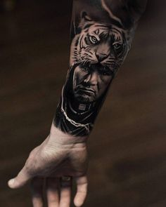 Black and grey native American warrior tattoo on the right inner forearm.