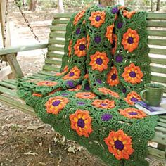 Big, bold flowers in vivid autumn colors celebrate the beauty of the season in this gorgeous afghan.