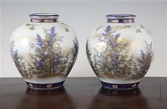 A pair of Japanese Imari ovoid vases, by Fukugawa, early 20th century, each painted with birds in flight amid bamboo, underglaze blue Koransha marks, 16.3cm.