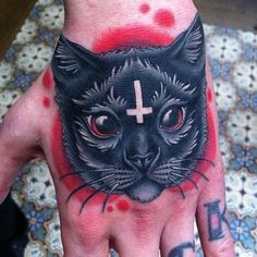 Evil kitty tattoo by Megan Massacre (New York).