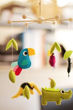 This hanging mobile contains 5 plushies that include anteater, 2 birds, ant, crocodile and leaves. They are designed and made by myself. I use wool felt