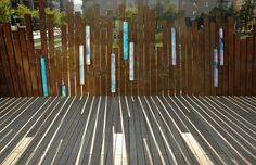 Fence with coloured glass // Dreiseitl