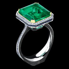 6,34ct Emerald, White Gold, Sapphire, Tsavorite and Diamond Ring