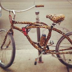 Leopard bike by Toad Lily, via Flickr - So, I was thinking about getting an old bike & wrapping it in cheetah duct tape, which you can buy @ Joann's Fabric store.,