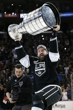LA Kings forward Justin Williams hoists the Stanley Cup after the Kings beat the New York Rangers 3-2 in double overtime in Game 5 of the NHL Stanley Cup Final at Staples Center. Williams was named the Conn Smythe Trophy winner as the tournament's most valuable player.