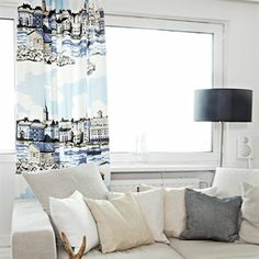 The beautiful curtain Pihlajasaari from Vallila has a lovely pattern which is inspired by the Swedish capital Stockholm with its buildings and the sea. This curtain fits perfect in a livingroom, combine it with other textiles in similar colors.