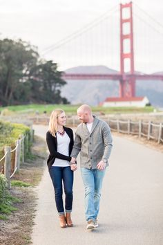 Engagement Portrait Golden Gate Bridge Holding Hands | San-Francisco-Engagement-Photographer-Baker-Beach-Crissy-Fields