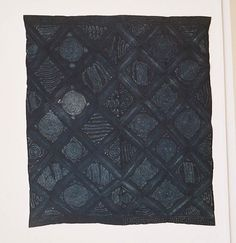 Adire alabere and oniko, 1975-86 Indigo dye with hand-stitched and tied resist on cotton 71.25 x 62.5 in. Henry John Drewal - Exhibition Photo