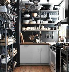 Take a cue from industrial kitchens and keep cooking equipment handy and accessible in a small #kitchen. #storage (Photo by: IKEA)