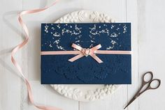 elegant navy blue and pink laser cut wedding invitations