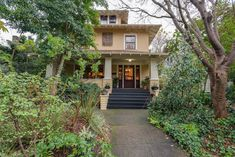 Centrally located in the Broadway/Irvington community, this stunning Portland style Craftsman home boasts impressive original details & amazing landscaping work that has been featured in both n…