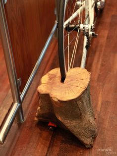 Clever bike rack from a chunk of wood/tree stump.