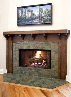 Designer Jeff Troyer gave this pre-fab fireplace a makeover by adding a new oak mantle and craftsman-inspired green tile. The changes spruce up the look of the fireplace while keeping it cohesive with the overall look of the home. Craftsman Living Rooms, Craftsman Tile, Craftsman Fireplace, Craftsman Interior, Bedroom Fireplace, Home Fireplace, Craftsman Style Homes, Fireplace Remodel, Craftsman Bungalows