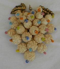 Vintage Pre Ban Carved Ivory Flower Beads Glass Seed Beads Gilt Brass Dress Clip. via Etsy.
