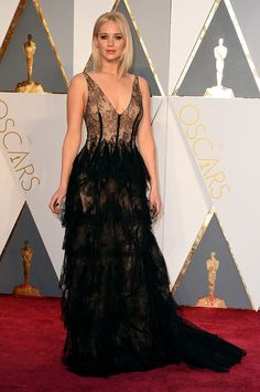 Jennifer Lawrence is wearing Dior Haute Couture at the 2016 Oscars.