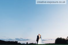 A shared kiss between the bride and groom outside birchwood golf club -photo by creative exposure photography - available for commissions uk & worldwide www.creative-exposure.co.uk