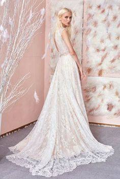 From the back #GALA803 is just as beautiful its voluminous ballgown skirt, made of sequin embossed tulle in ivory and diamond silver shades brings the drama. #GALAbyGaliaLahav #GALAno3 #BallgownWeddingDress #SpringWedding