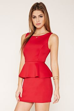 12 A knit peplum dress featuring a sleeveless cut 3229f1c46