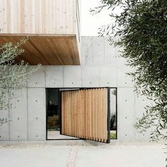 Architecture studio Robertson Design created a unique house that consists of a concrete and wooden box with a concrete wall. The design and shape of the Concrete Box House was inspired by the minimal aesthetic of Japanese architecture. Concrete Architecture, Architecture Details, Interior Architecture, Garden Architecture, Ancient Architecture, Sustainable Architecture, Building Architecture, Victorian Architecture, Classical Architecture