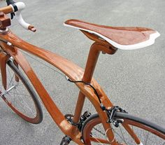 Mahogany bike by Sueshiro Sano. Constructed entirely of mahogany, including frame, fork, seat, seat post, handlebars/stem combination and even rims.