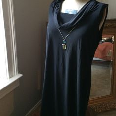 little black Cowl neck that goes under everything Wear alone sleeveless in summer, with a jacket in spring and fall. Take it to the club or take it to a party.  it doesn't matter... it's just that easy to throw on dress. Light weight and made of stretchy polyester/spandex. It says size 16 to 18 on the label. Dresses Midi