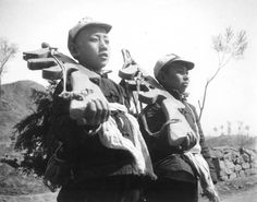 Chinese youth standing guard with wooden guns
