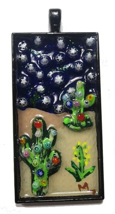 This Desert Cactus pendant was created with acrylic paint, Murano Millefiori and metal cacti. 24mm x 50mm. Part of the Cactus series. I created several versions of these. Signed. 2016.
