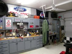 Traditional Garage with Built-in bookshelf, Concrete floors, flush light, Ceiling fan, specialty door