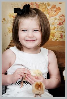 Cute Little Girl With A Brown Haired Bob