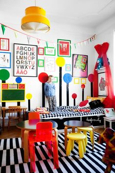 Use bold primary colors and stripes to create a bright, fun room for one lucky kiddo.