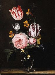 JAN VAN DEN HECKE (QUAREMONDE, NR. AUDENARDE 1620-1684 ANTWERP) ROSES, TULIPS, PRIMROSES AND OTHER FLOWERS IN A GLASS VASE, ON A WOODEN TABLE