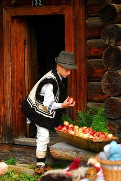 Choosing an apple, Bukovina. Bukovina (Romanian: Bucovina; Ukrainian: Буковина Bukovyna; Hungarian: Bukovina; German and Polish: Bukowina; see also other languages) is a historical region in Central Europe,[1][2] divided between modern-day Romania and Ukraine, located on the northern slopes of the central Eastern Carpathians and the adjoining plains.
