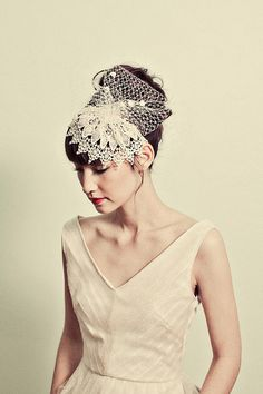 I love this lacey fascinator and this sparkly tulle party dress. Beautiful!