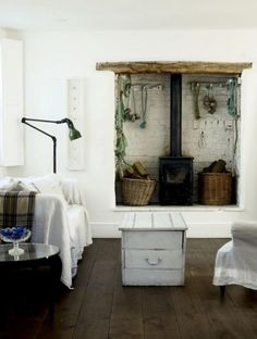 Rustic, and hearty fireplace with a cosy woodburner to keep you warm. This fireplace has style.