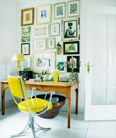 prints and art in eclectic frames - but elements of white and yellow to coordinate with the desk