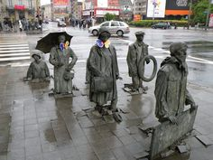 Statues Sink and Rise Out of Poland's Sidewalk. Artist Jerzy Kalina installed a total of 14 life-like statues. The public art installation is called Przejście, translated as Passage or Transition.