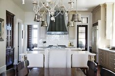 This lovely kitchen by the talented Erika Powell of Urban Grace Interiors features our Bead and Tassel Chandelier and our Single Sloane Street Shop Lights in Antique Nickel. Cottage Kitchens, Home Kitchens, Dream Kitchens, Painting Kitchen Cabinets, Kitchen Doors, Open Kitchen, Kitchen Backsplash, Visual Comfort Lighting, Classic Kitchen