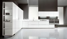 cube lacquer white glossy  with handle-less opening and lacquered plinth;  laminate white counter top Unicolor th.6cm.