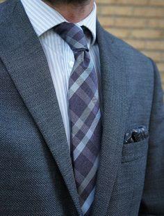 That herringbone jacket and plaid necktie!