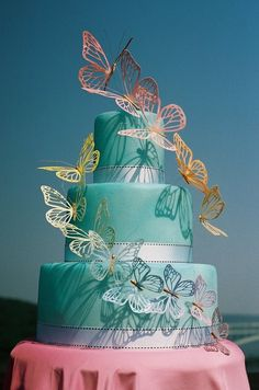 I assume these are wafer paper butterflies. I love the ombre effect as well as the 3D feel!
