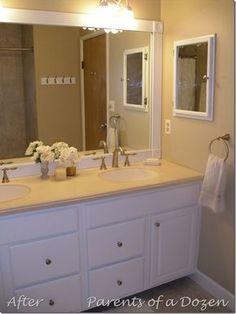 Framed Bathroom Mirror. Interesting...we could just frame that huge bathroom mirror.