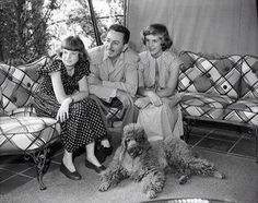 Walt Disney with daughters, Diane and Sharon, and their poodle....