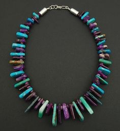 Necklace | Tommy Jackson (Navajo).  Sugilite, turquoise and sterling silver.