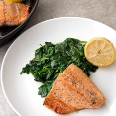 Apple Cider and honey glazed salmon served over sauteed spinach with a squeeze of lemon to top it off.  Healthy and delicious!