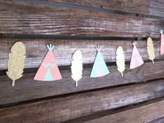 This Tribal Party Garland with Teepees and Glitter Gold Feathers will complete your tribal party theme! Use it as a backdrop with multiple strands or even decorate a sweets table with it! QUANTITY: ● 1 Tribal Party Garland COLORS: ● Glitter gold, Salmon, Light Pink, Mint SIZE: ●