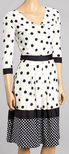 Interesting mixed pattern dress.  Cute waistline and neckline.
